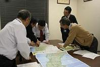 Officials from the JWWA discuss strategy <BR>for assisting areas impacted by the earthquake and tsunami.<BR> Strategy meeting at JWWA headquarters begin <BR>at least every two hours.